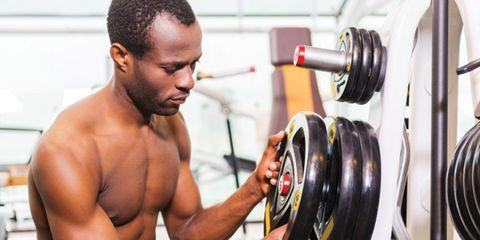 man choosing weights