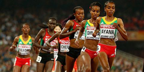 Sports uniform, Shoe, Track and field athletics, Human leg, Sportswear, Race track, Endurance sports, Sleeveless shirt, Running, Athlete,
