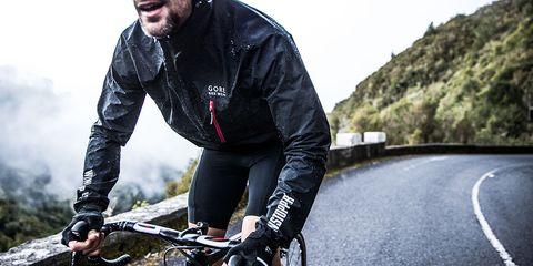 Cyclist riding in Gore Bike Wear Rescue Jacket