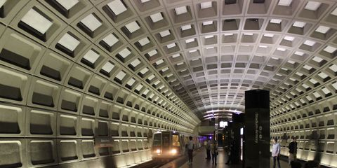 Infrastructure, Architecture, Transport, Train station, Standing, Ceiling, Urban area, Light, Metro station, Fixture,