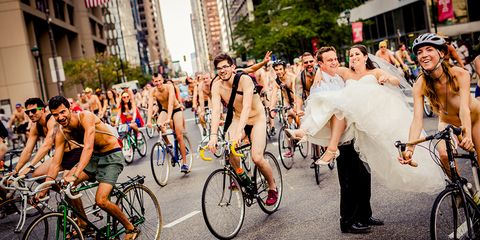Naked Bike Ride: bride and groom pose in the middle of naked cyclists in Philadelphia