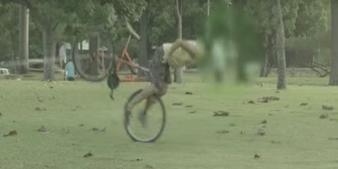 bike prank: thief endos the bike as he tries to ride away with it tied to a tree