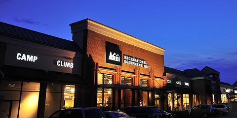 REI store lit up at night.