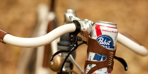 Bicycle handlebars with leather beer-can holder