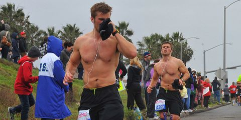 Footwear, Human leg, Active shorts, Shorts, Athletic shoe, Muscle, Barechested, Chest, Trunks, Running,