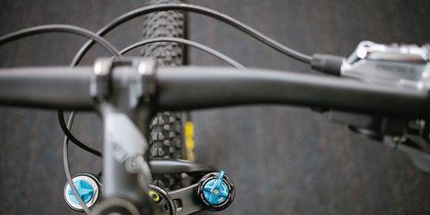Looking down at bike handlebars and mountain bike wheel
