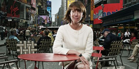 Former NYC DOT Commissioner Janette Sadik-Khan sits at a table in the Times Square pedestrian plaza she helped create.