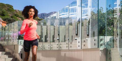 Human leg, Pink, T-shirt, Shorts, Athletic shoe, Magenta, Thigh, Knee, Commercial building, Active shorts,