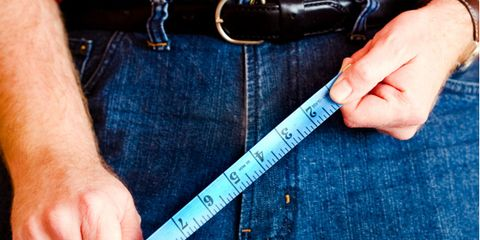 Finger, Textile, Denim, Wrist, Nail, Electric blue, Tape measure, Thumb, Measuring instrument, Number,