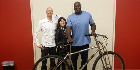 Shaquille O'Neal receives a custom 36-inch-wheeled bike