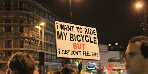 Woman with protest sign for bike safety
