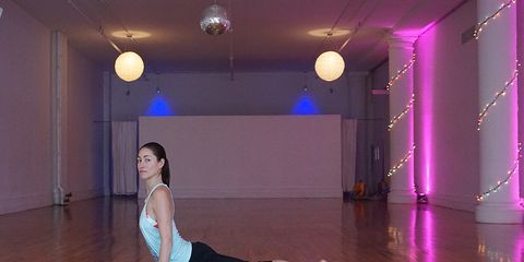 Tara in her NYC studio in a low lunge posture