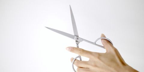 person holding scissors