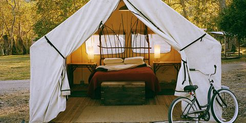 Outdoor tent with bicycles on porch