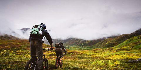 Mountain bikers riding through the Yukon