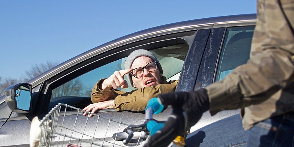 Angry motorist yelling at cyclist