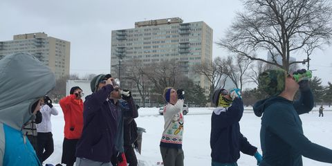 Members of the group Run215 ran a beer mile in a blizzard.