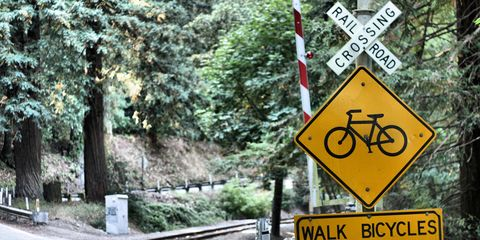 Sign advising dismounting from your bike before going across train tracks