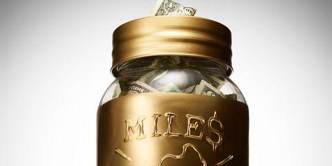Product, Bottle, Glass bottle, Font, Metal, Label, Cylinder, Brass, Silver, Lid,