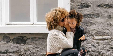 A woman and her daughter giggling