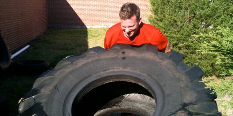 Ted Spiker flipping a tire