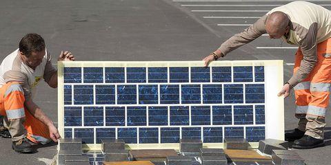 solar panels roads workers