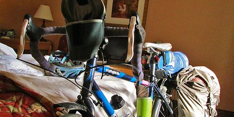 touring bike propped against bed in bedroom