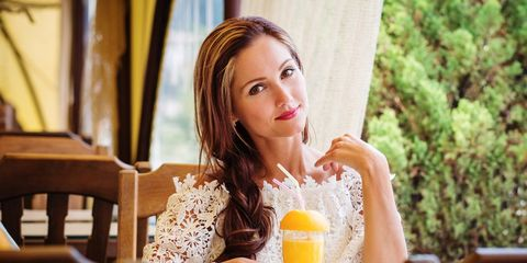 woman drinking juice that's good for the skin