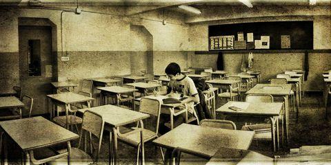 Student writing solo exam.
