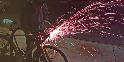 sawing through a u-lock to release a bike