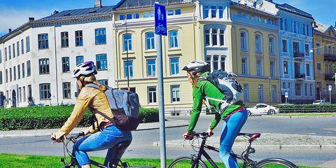 women cyclists riding bike path in Oslo Norway