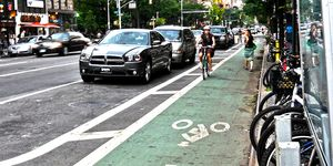 woman cycling in new york city bike lane