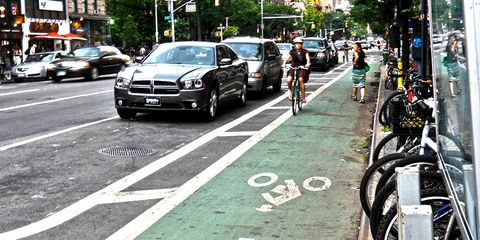 woman cycling in new york city bike lane