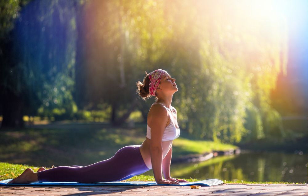 The Exact Yoga Poses You Should Be Doing for Any Running Goal