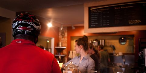 cyclist ordering coffee at a cafe