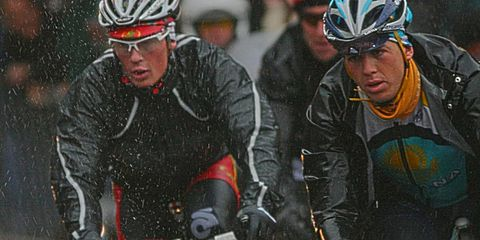 cyclists riding in the rain