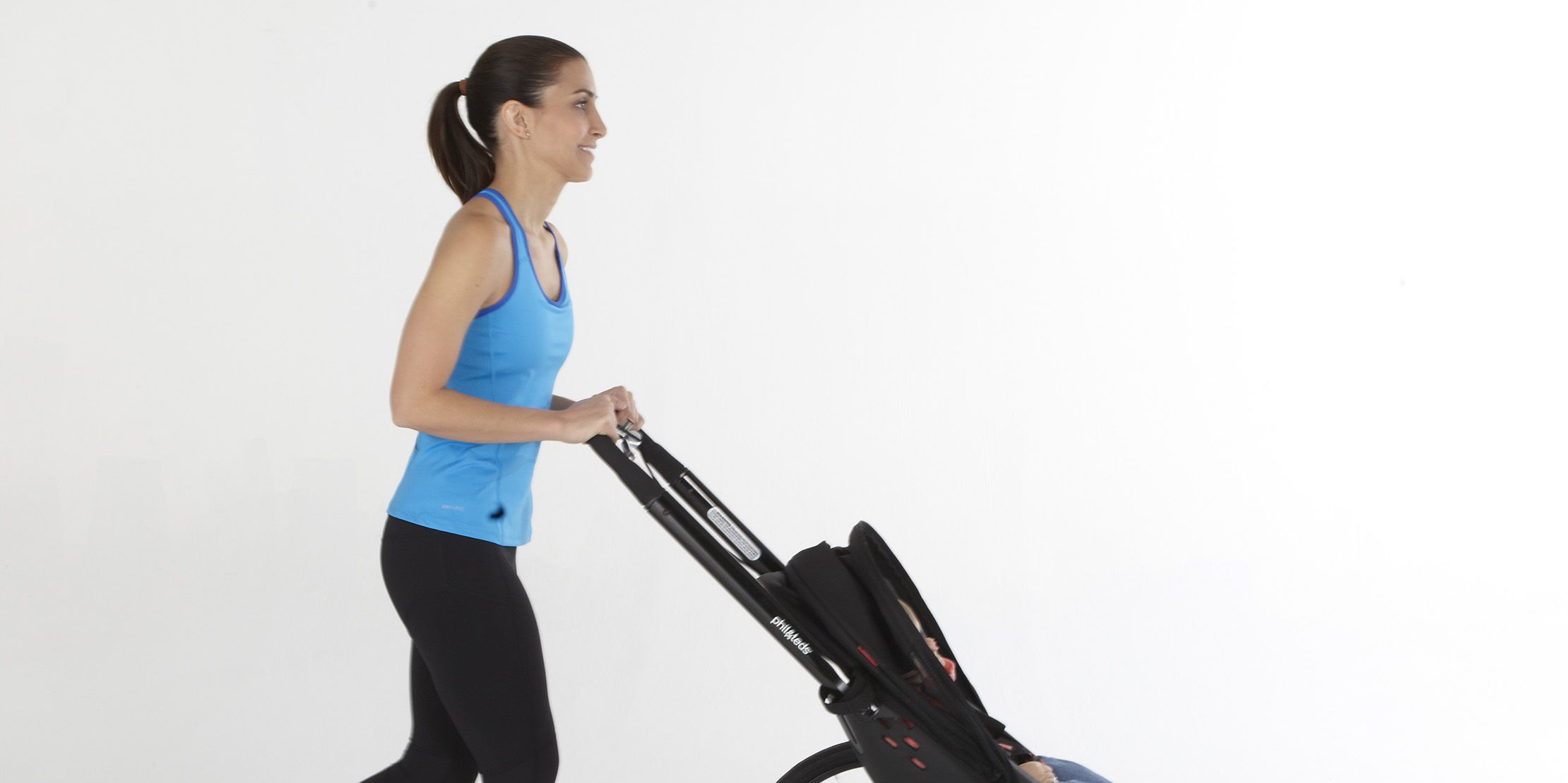 woman pushing jogging stroller
