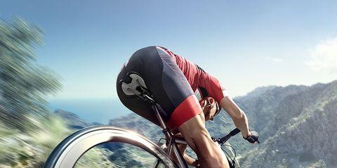 cyclist wearing chamois padding cycling shorts on road bike