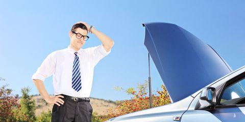 Confused man looking at car
