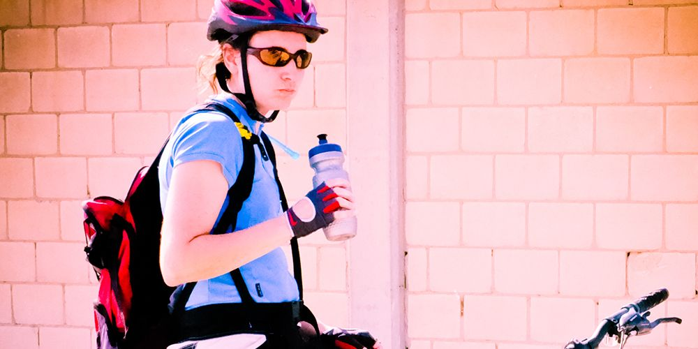 cyclist drinking water from water bottle