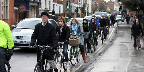 Cycling single file in Oxford Iffley Road.