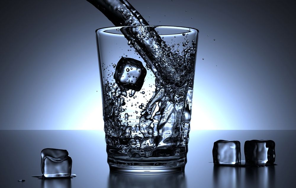 Here's How Much Water You Should Drink Before, During, and After a Workout