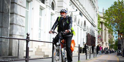 man riding bike path in budapest hungary