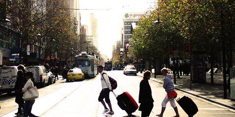 Pedestrians crossing a road.