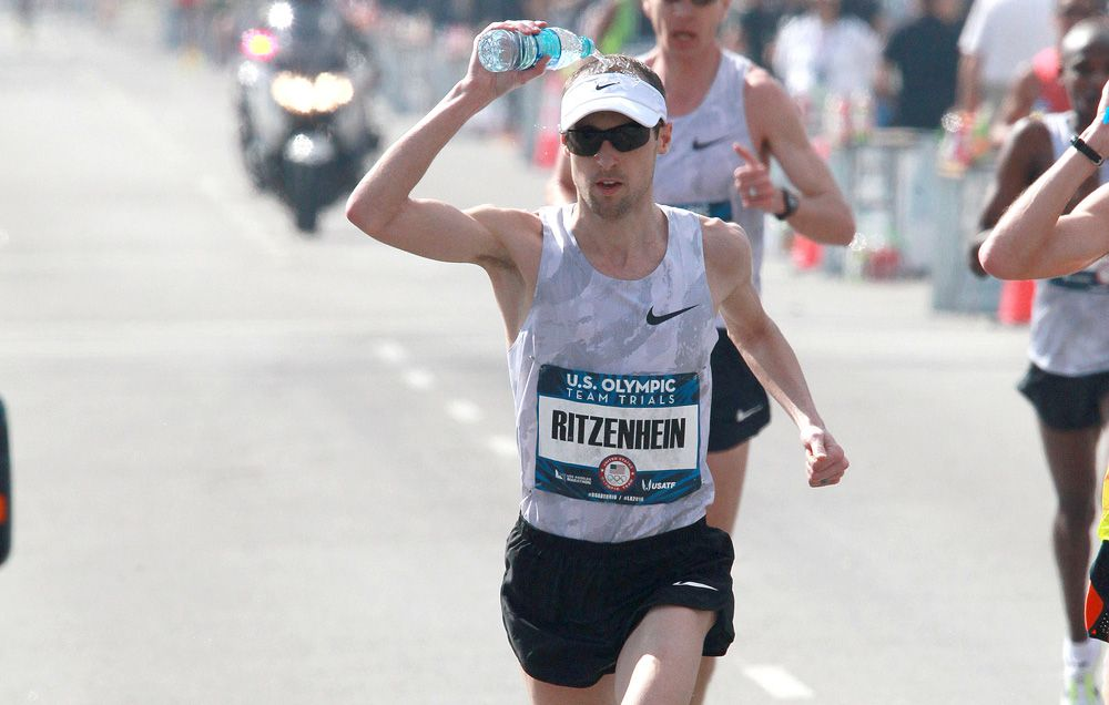Should You Drink Water or Pour it on Your Head? | Runner's World