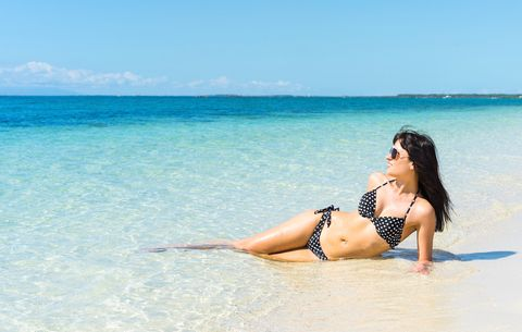 The right way to wax your own bikini line womens health woman in bikini solutioingenieria Choice Image