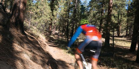 mountain biker riding trail