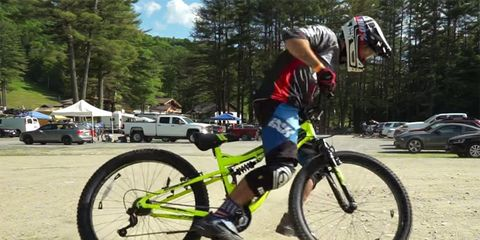 MTB expert Phil Kmetz tests a Huffy department store bike from Walmart on a downhill course