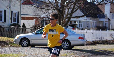 woman in yellow runs