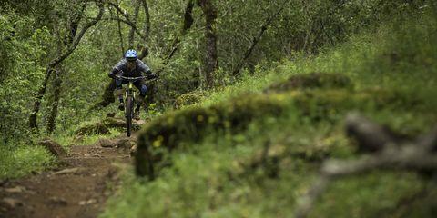 mountain biker using a seat dropper